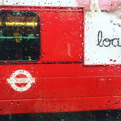London as we know it. The London bus keeps life moving despite a summer rain shower.