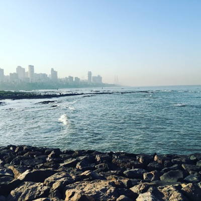 Apartment buildings along Mumbai's coast are barely visible through the smog. Despite the pollution in this city of more than 20 million people, the Arabian Sea is a big draw for visitors from across India and the rest of the world.